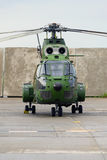 Military helicopter. Romanian Air Force IAR 330 military helicopter (Aerospatiale SA 330 Puma) on a helipad, outdoor Stock Image