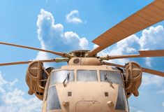 Military helicopter rotor with blue sky background Stock Photo
