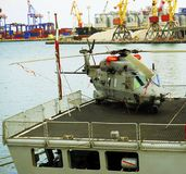 Military helicopter, on the ship stock photo