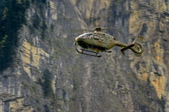 Military helicopter in the sky, Alps Royalty Free Stock Images