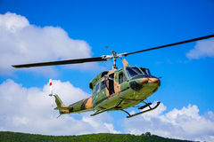 Military helicopter on the sky Stock Images