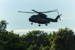 Military helicopter in the sky. Close up of a military helicopter in flight Stock Photography