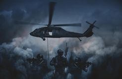 Military helicopter between smoke and fire stock photo