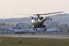 Military helicopter taking off in the evening stock photo