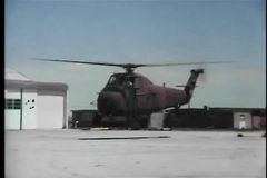 Military helicopter taking off from helipad stock video
