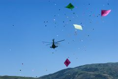 Military helicopter throws festive flyers Stock Photography