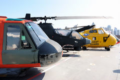 Military Helicopters. Various helicopters on deck of The Intrepid Aircraft Carrier in New York City Stock Image