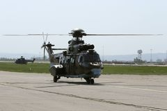 Military helicopters at the airport Stock Images