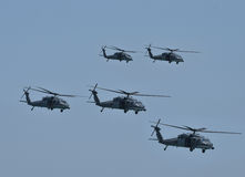 Military helicopters in flight Stock Images