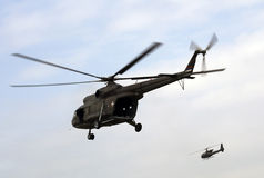 Military helicopters in flights Stock Images