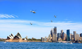 Military helicopters fly over Sydney Australia Stock Photo