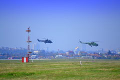 Pair military helicopters low altitude Stock Images