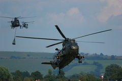 Military Helicopters on maneuvers. A photo close up of a Military helicopters used by the British Royal Navy on a mild english afternoon. Made possible by Royalty Free Stock Image