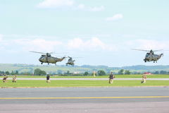Military Helicopters. A photo of Military Aircraft on practice maneuvers used by the British Royal Navy on a mild english afternoon. Made possible by yeovilton Royalty Free Stock Images