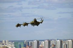 Military helicopters in the sky. Moscow city panorama. Military helicopters in the sky. Military parade general rehearsal in Moscow. Moscow city panorama. Birds Stock Image