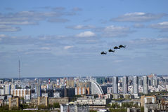 Military helicopters in the sky. Moscow city panorama. Military helicopters in the sky. Military parade general rehearsal in Moscow. Moscow city panorama. Birds Royalty Free Stock Photo