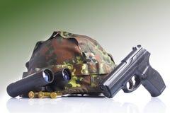 Military helmet and binoculars and gun Royalty Free Stock Image