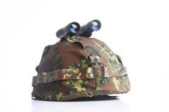 Military helmet and binoculars Stock Photos
