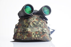 Military helmet and binoculars Stock Image