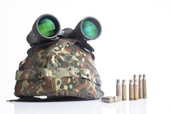 Military helmet and binoculars Royalty Free Stock Image