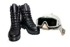 Military helmet and boots Stock Photo