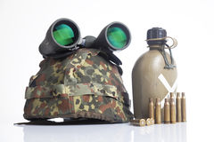 Military helmet and bullets Stock Photo