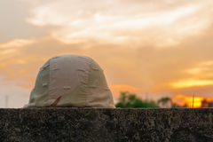 A military helmet. Of desert camouflage with gray sunset background Stock Photography