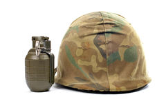 Military helmet and grenade Royalty Free Stock Photo