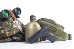 Military helmet and gun Royalty Free Stock Photos