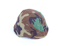 Military helmet in woodland camo Royalty Free Stock Image