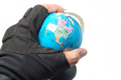 Military hold globe in hand stock photo