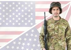 Military holding a weapon against american flag Stock Photos