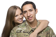 Military Husband and Wife hugging. A hispanic military men and his wife hug royalty free stock photography