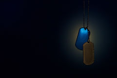 Military ID tags on a dark background Stock Photo