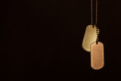 Military ID tags on a dark background Royalty Free Stock Image