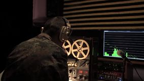 Military puts on headphones and starts recording stock video footage