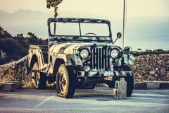 Military jeep khaki. Khaki military jeep in the mountains on the island of Zakynthos, Greece Royalty Free Stock Photography
