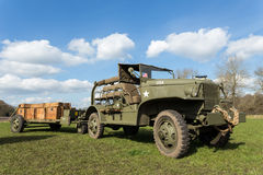 Military jeep pulling trailer carrying wooden boxes with bullets Royalty Free Stock Image