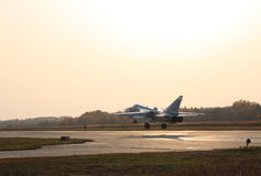 Military jet bomber airplane Su-24 Fencer. On take off and landing stock photos