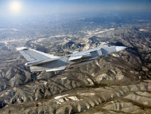 Military jet bomber Su-24. Against mountains stock images