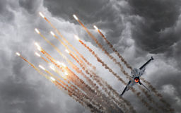 Military jet firing of flares Stock Photos