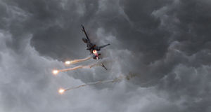 Military jet firing of flares Royalty Free Stock Images