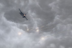 Military jet firing of flares royalty free stock photo