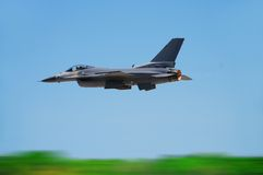 Military jet in flight. Fighter jet in flight with motion blur stock image