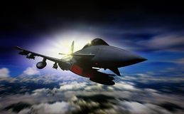 Military jet flying during sunrise with blur motion. Background Royalty Free Stock Images