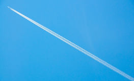 Military jet plane in the sky (with traces) Royalty Free Stock Images