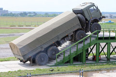 Military KAMAZ truck overcomes stairs Stock Photos