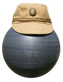 Military khaki cap on the plastic ball black Royalty Free Stock Photos