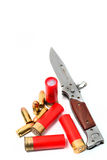 Military knife with shotgun bullet Stock Photo