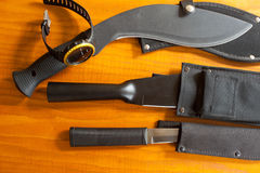 Military knives and scabbard isolated on the wooden background Royalty Free Stock Photos